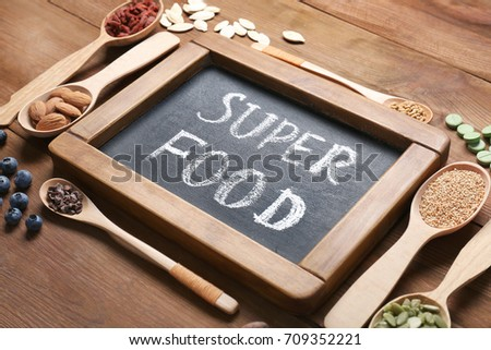 composition chalk board assortment superfood products stock photo