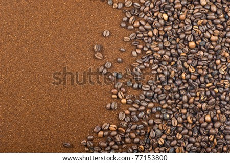 Composition with coffee beans and grounded coffee.Studio background. - stock photo