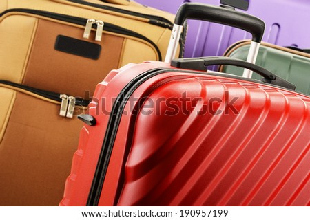 Composition with colorful travel suitcases - stock photo