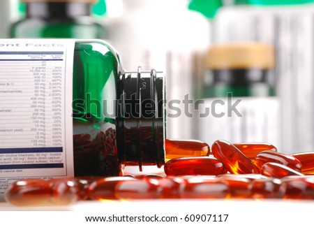 Composition with containers of dietary supplements and capsules - stock photo