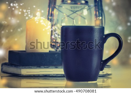 Composition with cup and candles on table