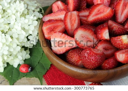 Composition with cut strawberry - stock photo