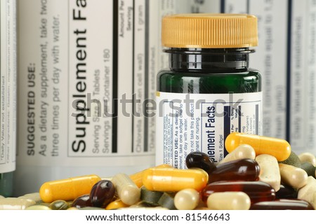 Composition with dietary supplement capsules and containers. Variety of drug pills - stock photo