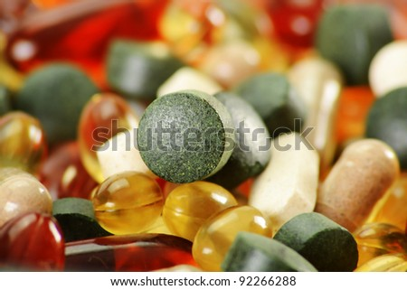 Composition with dietary supplement capsules and tablets. Variety of drug pills - stock photo