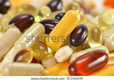 Composition with dietary supplement capsules. Variety of drug pills - stock photo