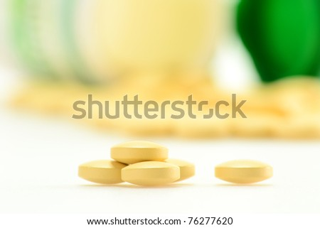 Composition with dietary supplement tablets - stock photo