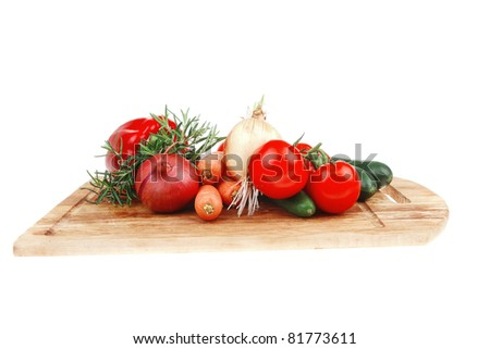 Composition with Different raw Vegetables isolated over white background on kitchen board - stock photo
