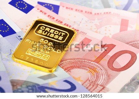 Composition with Euro banknotes and Swiss gold bar - stock photo