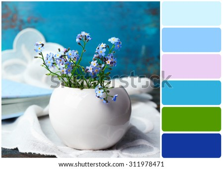 Composition with Forget-me-nots flowers and palette of colors - stock photo