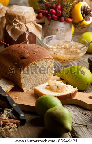 Composition with fresh fruits, bread and homemade jam on old wooden table