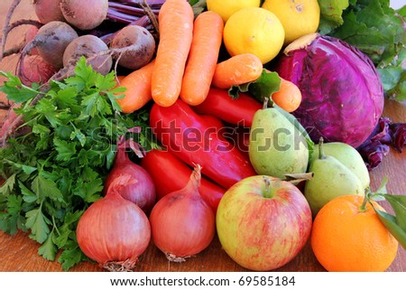 Composition with fresh raw vegetables and fruits - stock photo