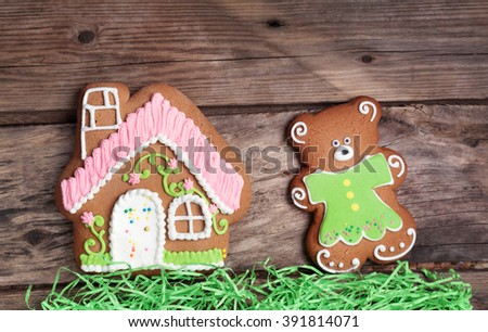 Composition with gingerbread house and Teddy bear  - stock photo