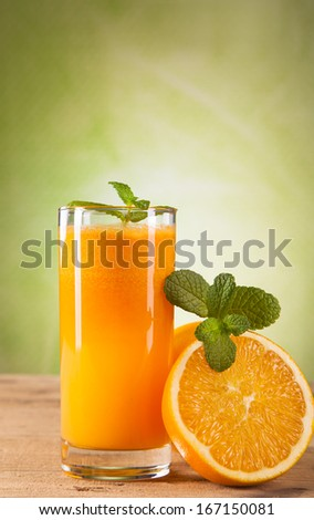 Composition with glass of orange juice
