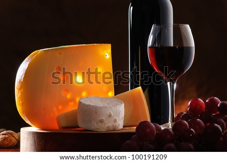 composition with grape, wine and various types of cheese - stock photo