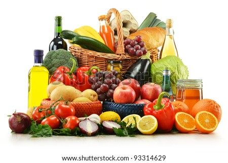 Composition with groceries and basket isolated on white. Vegetables, fruits, wine and bread. - stock photo