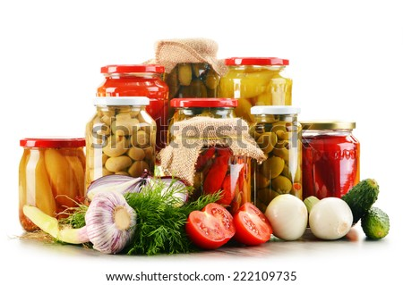 Composition with jars of pickled vegetables. Marinated food. - stock photo