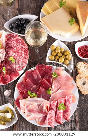 composition with meat, heese and wineglass - stock photo