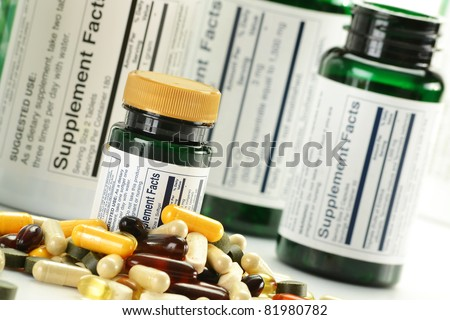 Composition with nutritional supplement capsules and containers. Variety of drug pills - stock photo