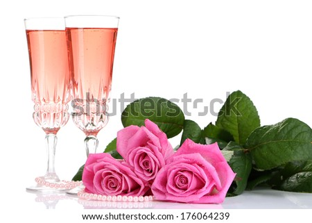 Composition with pink sparkle wine in glasses and pink roses isolated on white - stock photo