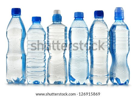 Composition with polycarbonate plastic bottles of mineral water isolated on white background
