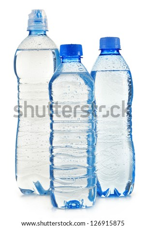Composition with polycarbonate plastic bottles of mineral water isolated on white background - stock photo
