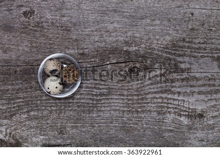 Composition with quail eggs. Wooden texture for background.