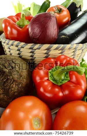 Composition with raw vegetables and kitchen dish