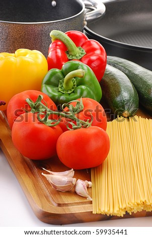 Composition with raw vegetables and spaghetti - stock photo