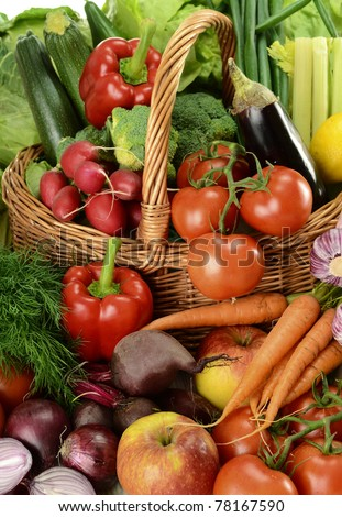Composition with raw vegetables and wicker basket - stock photo
