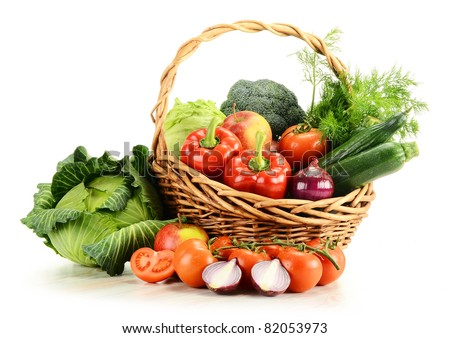 Composition with raw vegetables and wicker basket isolated on white