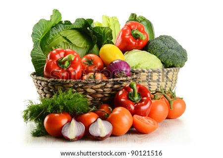Composition with raw vegetables and wicker basket isolated on white - stock photo