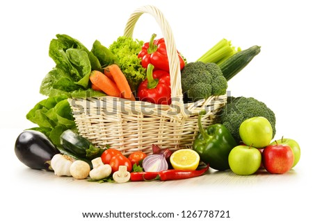 Composition with raw vegetables in wicker basket isolated on white - stock photo