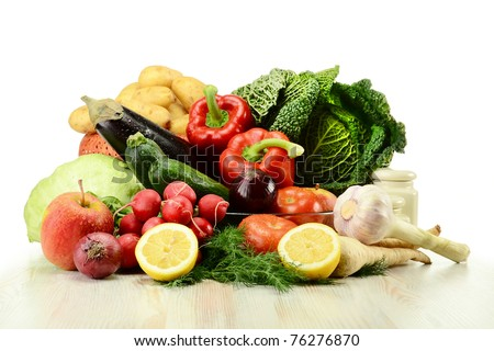 Composition with raw vegetables on kitchen table - stock photo
