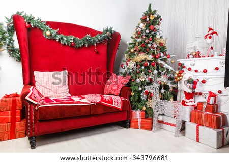 composition with red chair and Christmas tree with balls