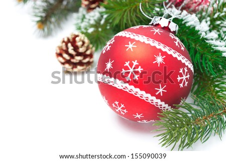 composition with red Christmas ball and fir branches isolated on white background - stock photo