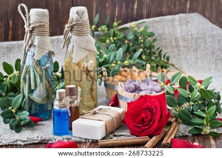Composition with sea salt, stones, candles,soap and flower - stock photo