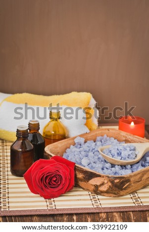 Composition with sea salt, towel, candles,infusion of herbs and flower