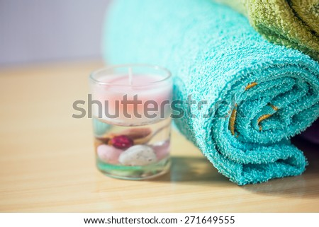 Composition with spa treatment, towels and candle - stock photo