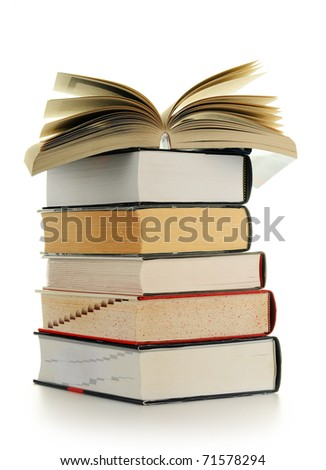 Composition with stack of books on table - stock photo