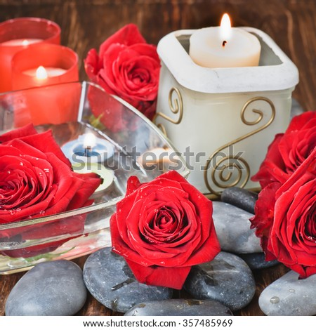 Composition with  stones, candles and flower