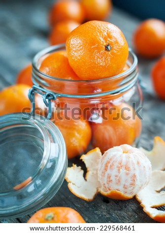 Composition with Tangerines in a Jar. Rural style. Russian tradition to eat this fruits on Christmas - stock photo