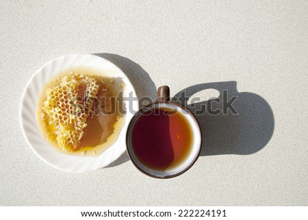 Composition with tea in cup and teapot on table, on  white background