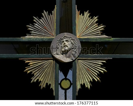 Composition with the face of Jesus Christ carved on a steel plate. - stock photo
