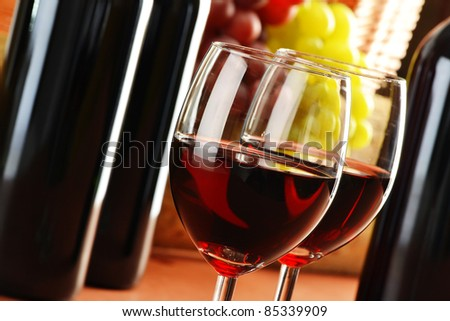 Composition with two glasses and bottles of wine - stock photo