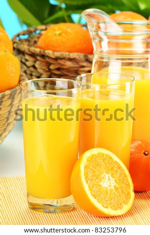 Composition with two glasses of orange juice, fruits and pitcher - stock photo