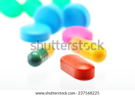 Composition with variety of drug pills and container - stock photo