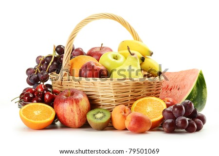 Composition with variety of fruits and wicker basket - stock photo