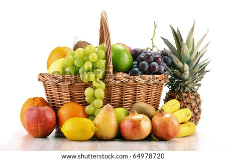 Composition with variety of fruits and wicker basket isolated on white - stock photo