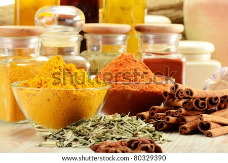 Composition with variety of spices on kitchen table - stock photo