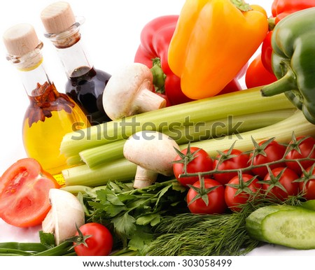 Composition with vegetables and salad dressing - stock photo